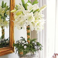 Create a Topiary! Start with a silver casserole dish. Gather 8 to 12 stems of 'Casablanca' lilies in one hand, & cut stems about 15 inches long. Wrap a rubber band around stems at top & also 5 inches from bottom. Insert bundle into center of water-soaked florist foam fitted into casserole dish. Wrap stems with crisscrossed ribbon to hide rubber bands. Add evergreens & tie on ornaments with wire.