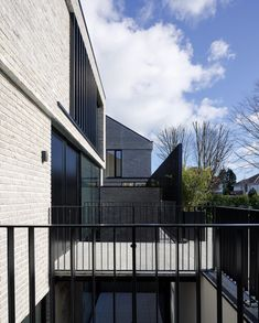 View of steel access bridge to oen of two brick houses over courtyard garden Brick Houses, Walkway, Bridge, Steel, Contemporary, Mansions, Architecture, House Styles, Garden