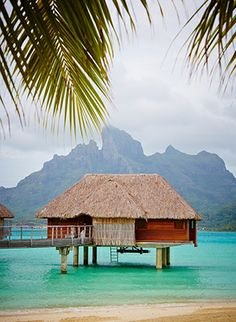 The extinct volcano dominates the views behind the over-water bungalows at @Four Seasons Resort Bora Bora.