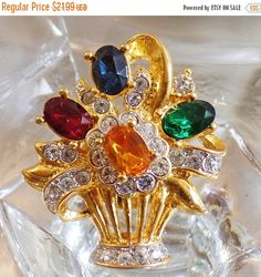 This #vintage rhinestone flower bouquet brooch is sparkling and gorgeous!  It features a gold plated floral bouquet with clusters of flowers encrusted with clear rhinestones... #ecochic #etsy #jewelry #jewellery