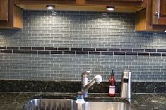 Same idea...picture white subway tile with the glass tile accent stripe like this...