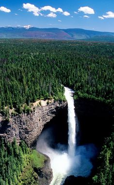 Helmcken Falls, with view of Canadian Rockies in background (vertical), Wells Gray Provincial Park, British Columbia, Canada