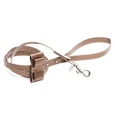Bronze Double Bow Leash From the attractive Inamorada Collection we present the double bow dog's lead with the cute two- fold effect for timeless luxury. It is an ideal companion to the harness or double bow collar. Hand-finished in Italy from top-quality materials.