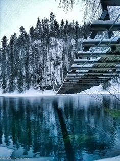 winter suspension bridge, kuusamo's harrisuvanto, finland | travel destinations in europe + architecture #adventure