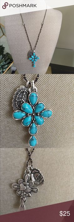 """Lucky brand cross necklace turquoise silver This fun, bohemian Lucky Brand necklace is the perfect accessory for spring. Blue green turquoise cross. Especially this time of year before Easter. Cute peace sign and rose image on the 2nd pendant. Cross measures 2"""" x 1.25"""" chain length around the neck is 20"""" Lucky Brand Jewelry Necklaces"""