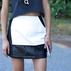 HP[minkpink]black & off white faux leather skirt Very stylish faux leather skirt! It's off white and black faux leather w patent leather accents. The white part of the skirt has some faint stains as seen in pic #3 but hardly noticeable  when worn. Price reflects this flaw. MINKPINK Skirts Mini