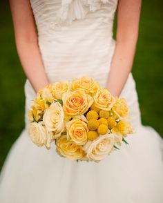 Lisa carried an all-yellow bouquet of craspedia and roses.
