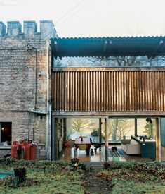 The rear facade reveals a glimpse of the living room.  Photo by Ben Anders.