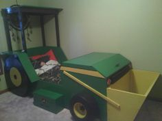 My father in law helped me with this one! Tractor bed. We built a toy box in the hood and the scoop is a toybox! #tractorbed