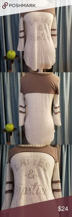 🌻🌺MAURICES DISTRESSED LATTES & LIPSTICK TUNIC!! SIZE:small   BRAND:Maurices   CONDITION:like new, no flaws    COLOR:brown and gray  SUPER SOFT!! 3/4 inch sleeves   🌟POSH AMBASSADOR, BUY WITH CONFIDENCE!   🌟CHECK OUT MY OTHER ITEMS TO BUNDLE AND SAVE ON SHIPPING!   🌟OFFERS WELCOME!   🌟FAST SHIPPING! Maurices Tops