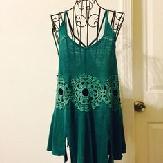 Free People Tank Top Beautiful green Free People tank top. Color is Shamrock, appears to have a teal-ish hue to it. Spaghetti straps with T style back. Large floral crochet areas through mid section. Hem line has decorative slits. Open, loose fit. NWT, size Medium. Free People Tops Tank Tops