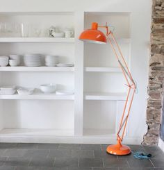 A fantastic floor standing angled lamp in a vibrant tangerine finish.This adjustable floor lamp comes in a really gorgeous vibrant orange and is great to have over your desk or beside a chair or sofa as a reading light. It has a good, sturdy base and so can also just be used as a free standing lamp to add a funky, contemporary feel to a room.Metal190x36x36cm