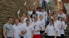Greenwich University athletes with tap water stainless water bottles.