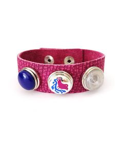 What's an ensemble without some personal pizzazz? With this genuine crackled leather bracelet's trio of interchangeable Chunkies charms, a custom, colorful bauble is just a few snaps away.