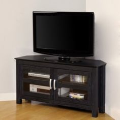Add elegance and functionality to your home decor with a contemporary TV consoleLiving room furniture is constructed of sturdy PVC laminate and MDF boardEntertainment center will accommodate most flat-screen televisions up to 52 inches