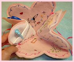 folding needle case.  The butterfly or the heart fold up.