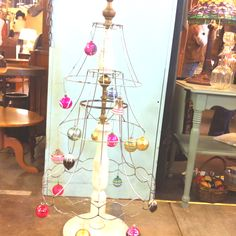 Upcycle a lampshade into a Christmas Tree! Different to say the least!  Could also be used for Easter!