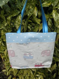 Caravans of Love oilcloth holiday tote, fully lined in moisture resistant fabric, with contrast spot base and top. www.etsy.com/shop/dagenaisdesign