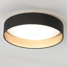 "Elegant simplicity defines this ceiling light, which features a dimmable LED lighting array within a white diffuser ringed by a two toned fabric shade. Available in Black with Gold inner, Cappuccino with Gold inner, and Gray with Silver inner finishes. 18 watt 1720 lumens, 3000 K LED array included. (4.12""Hx16""W) Canopy (1.25""Hx5""W)."