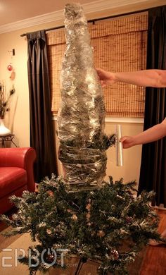 If you store your artificial tree in the garage, this trick will keep it clean and protected all winter, spring, and summer long. When you're ready to decorate it next year, just slice up the side of the wrap with scissors and fluff the branches into shape.