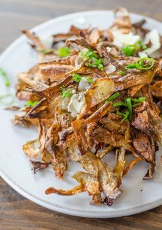 Make vegetable crisps: Mix potato, carrot, parsnip, etc peels with a little oil and spices (eg garlic powder, dill weed, chipotle, curry powder, ranch mix) to coat. Place in a single layer on a baking sheet; bake at 400°F until slightly browned and crispy, 8-10 mins. | The Kitchn