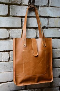 Large genuine high quality cow leather handbag sewed with a lot of care and attention.  Its perfect as an every day tote.    - handbag comes with 2