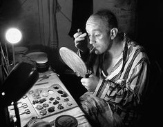 Alec Guinness puts on his make-up during a run at at the Stratford Shakespeare festival in 1958.