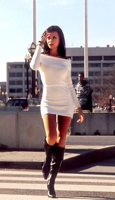 Mini sweater dress with boots..