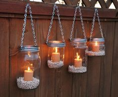 Hanging Mason Jar Garden Lights DIY Lids Set by TheCountryBarrel I can do this for the backyard! Switch out candles for battery or LED candles. Hang from shepherds poles or from the tree.