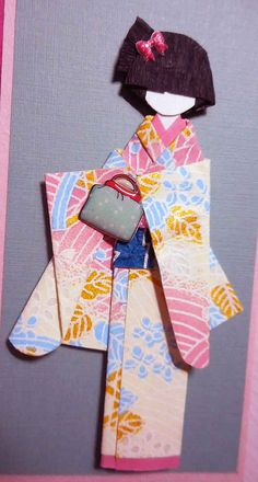 All-purpose handmade card 58_closeup of origami doll. Doll hand-folded using yuzen washi (kimono and obi) and 3-D Japanese stickers for accessories. Doll height: 8.6 cm.