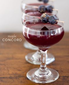 Maple Concord Cocktail:  3/4 cup maple syrup  3/4 cup warm water  2 cups Concord grape juice  2 cups gin  1/2 cup fresh lemon juice  Fresh Concord grapes, for garnish  1/4 cup demerara sugar, for garnish  1 large serving bottle  Toothpicks or small skewers  Cocktail glasses   Gather your ingredients. Gently stir together the maple syrup and warm water until thoroughly combined. CHEERS!