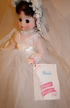 """Beautiful 17"""" tall brunette bride with bouquet and tag still on wrist. Complete with shoes,stockings and veil - appears never to have been played with. No box Elise would be a beautiful addition to an"""