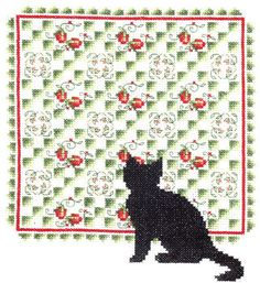 A pretty picture of a quilt with strawberries and flowers and a black cat in silhouette.