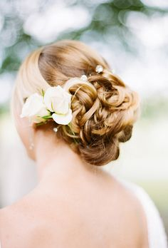 Brides: Romantic Wedding Updo with Roses. The bride also wore roses in her hair, provided by florist Stephanie Fasould at Lavender Green.