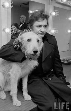 Johnny Cash and Sandy the dog backstage at the Broadway production of the musical Annie.