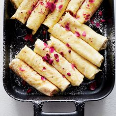 These delicate, Middle Eastern–inspired crêpes filled with ricotta and mascarpone get their aromatic sweetness from rosewater and honey.