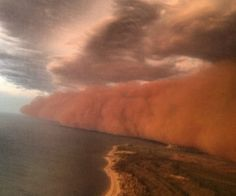 Menacing: The towering red dust storm is pictured rolling across the ocean as it approaches Onslow in West Australia Coast Australia, Western Australia, Dust Storm, Storm Clouds, Huge Waves, National Weather, Wind And Rain, Thunderstorms, Tornadoes