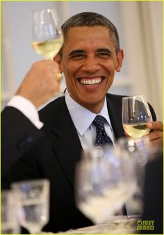 President Obama is all smiles while attending a dinner at the Orangerie of Schloss Charlottenburg palace on June 19,2013 in Berlin,Germany