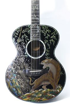 YAMAHA LJ66 custom guitar with elaborate inlays.