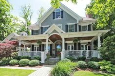 omg - I could actually see me on that porch, or upstairs, or inside or anywhere in this gorgeous home #lowmaintenancelandscapeonabudget