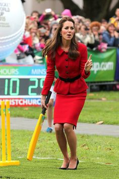 Catherine, Duchess of Cambridge, aka Kate Middleton, participated in a game of cricket with some school children in Christchurch, New Zealand, where the 2015 Cricket World Cup will be held. Kate is wearing a modified version of her Luisa Spagnoli suit, Episode Angel black suede pumps, Mulberry Bayswater clutch and her Annoushka Pearl Drop earrings. 4/14/14