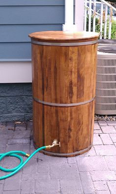 Lovely Rain Barrel for your garden! You could also use a large barrel, but to make it look nice make a little wood box around it, and make it into a nice bar table for your patio!