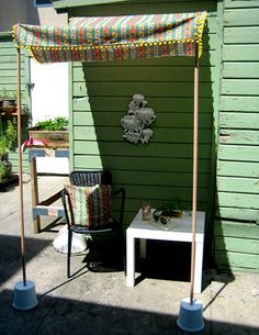 thinking about something like this for the patio--stakes in heavy flower pots, not plastic buckets!