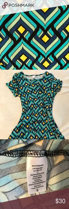 Lularoe Carly (small) This is a Lularoe Carly dress in size small. Excellent, like new condition. Vivid colors and fun unique pattern! LuLaRoe Dresses Midi