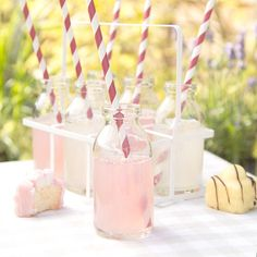 Retro school milk bottlesSet of SixGifts don't come much more retro than this blast-from-the-past crate of school milk bottles that bring back memories of our daily milk allowence.. In a white metal crate with carrying handle these would make a great addition to any party or occasion. Use them to put classic drinks in with a fun straw or they also look good with a single stem flower.   Each 100ml bottle is 10cm high, with a diameter of 4.5cm at the base and 2.3 cm at the neck. Hand ...