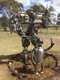 This is our new mail box which is 2.7 metres tall and weighs 700 kg. It is mostly made out of old Holden car parts.