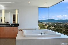 Love that seamless corner window around the tub.  Free-standing Agape tub would have been sooo much better! :)