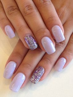 Eye catching Silver and Purple Glitter Nails.