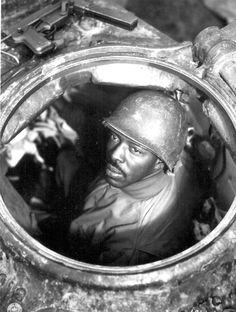 """Cpl. Carlton Chapman...is a machine-gunner in an M-4 tank, attached to a Motor Transport unit near Nancy, France."" 761st Mt. Bn. November 5, 1944. Ryan. 111-SC-196106-S."