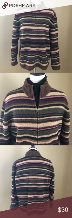 JONES NEW YORK SPORT Wool Cardigan Zipper Sweater You'll be a headturner in this gorgeous multi-colored zipper cardigan by Jones New York! 100% wool, hand wash or dry clean. With so many colors to choose from you can't go wrong pairing it up! The colors range from three shades of brown (dark chocolate/taupe/tan) to a mulberry pink, there's also a burgundy and a deep green - absolutely gorgeous! I've always received compliments when wearing this sweater. This sweater is in great shape and is…